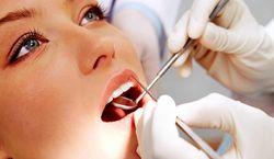 Осмотр стоматологом