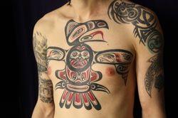 Татуировка на теле парня